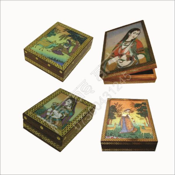 GEM STONE PAINTING WOODEN BOXES made by the hands of the expert artisan of jaipur with fineness Quality Hand Painted Gem Stone Art work painting. Gem Stone Painting Wooden Boxes made of Colorful Gem Stone Art Work Paintings in Different Design which is fitted on the quality carved wooden boxes which is perfect addition for the shelf , Dressing table or gift purposes. We