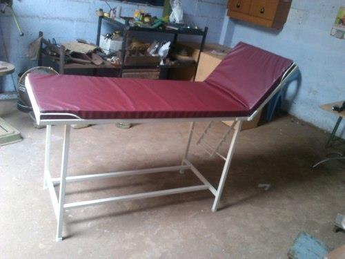 Hospital Examination Table  Keeping in mind all the suitable requirement of patient to be examined we offer a wide range of Hospital Examination Bed to our clients. This range is well designed and is extensively demanded all around the nati - by S M INDUSTRIES, Coimbatore