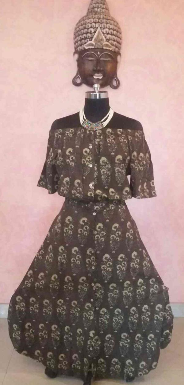 This one is a Total Indo-Western fusion... An Off-shoulder long dress in a Beautiful Kalamkari motif cotton material. ..  can be made in various colours and cloth with varied patterns...