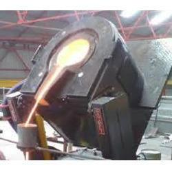 MELTING  FURNACE: This is the furnace can be used melting some metals like Brass, Copper, Aluminum, steel etc.,  the furnace is designed to melt up to 2000 deg centigrade, using the suitable  crucible.  The high resistance wire is wound and mounted on the ceramic bricks designed specially for this to get adequate temperature.  It is brick lined to the desired space required and is cased in the MS cabin. The rating is decided as per the requirements.