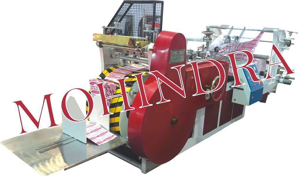 Paper Bag Making Machine Bag  Making  Machine is made of rigid and robust construction to avoid vibration. all paper are arranged in most accessible way thus making operation and adjustment very simple and quick so that even an unskilled la - by Paper Bag Making Machine // Automatic Paper Bag Making Machine //Mohindra Mechanical Works # 09999778804, New Delhi