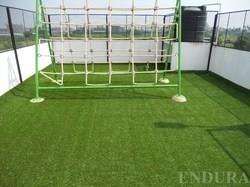 ARTIFICIAL TURF CONTRACTOR IN CHENNAI Artificial grass brought to you by ENDURA are long lasting, fade proof, fire retardant and insect-free. The grass made of UV resistant yarns are tough enough for outdoor games and soft to cushion accide - by Endura Floors & Furnishings, Chennai