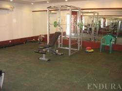 Gym Flooring Contractor in Chennai Gym Flooring Synthetic resic courts - A mixture of acrylic polymers, minerals, cellulose fibers & rubber particles to offer maximum comfort & quality and in attractive colours as per the specifications. - by Endura Floors & Furnishings, Chennai