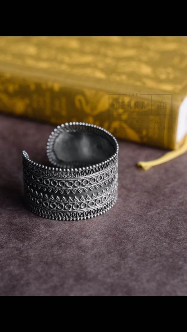 This statement cuff in silver can be styled with any look out of your wardrobe- traditional or modern, casual or dressy-just make sure it tells your story !  Product code: 1002JR49 Price: Rs. 4990