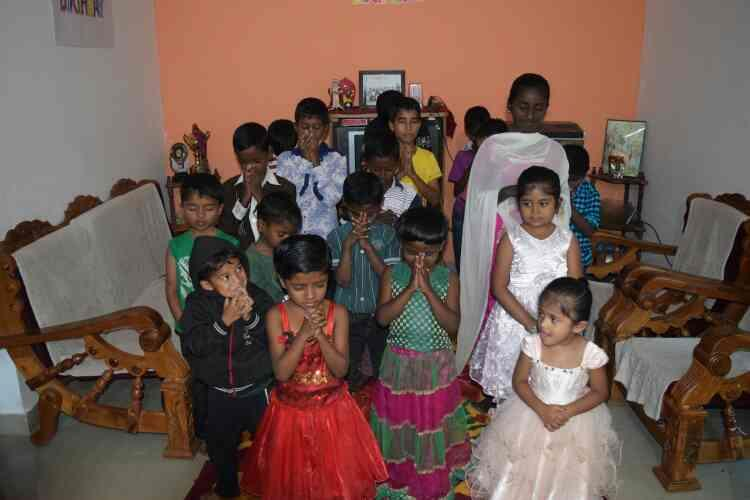 our children thanking God for making this day happy and 3 families joined our home and shared their wonderful time, food, stationery & new clothes. thank God for this memorable occasion. God bless you all. - by Rays Of Hope, Bengaluru