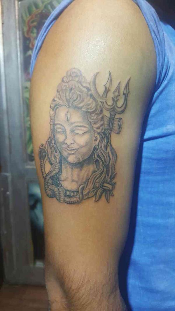 shiva tattoo design by artist Abhijeet Dhaila at Delhi's best tattoo institute RIP tattoos studio located at south Delhi lajpat nagar. shiva means shakti or power.lord shiva tattoo design is most unique of all Hindu gods.and also the gods o - by R.I.P Tattoos, New Delhi