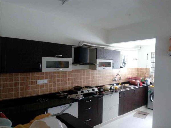 kitchen cum utility area - by Vsquare Interior Design pvt ltd, Bangalore