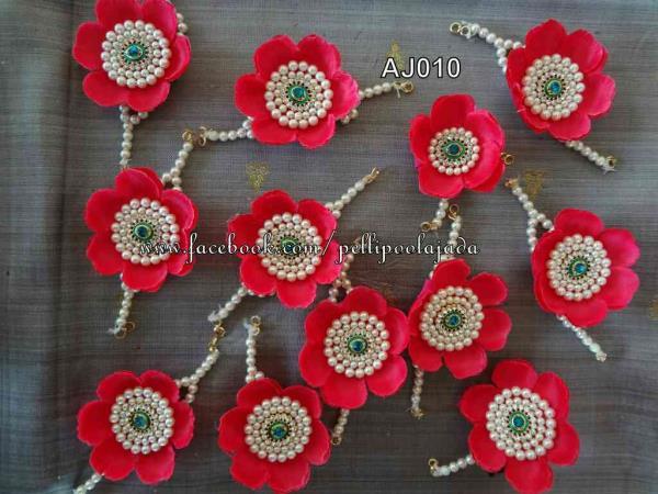 Artificial flower poolajada #pellipoolajada #Artificialflowerpoolajada #mogginajade #poojadai #weddingflowerjadai #weddingjada #rosepetaljada #rosejada #lightweightpoolajada
